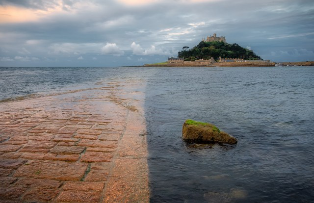 Stone path to St. Michaels Mount from Marazion in Cornwall submerged in water