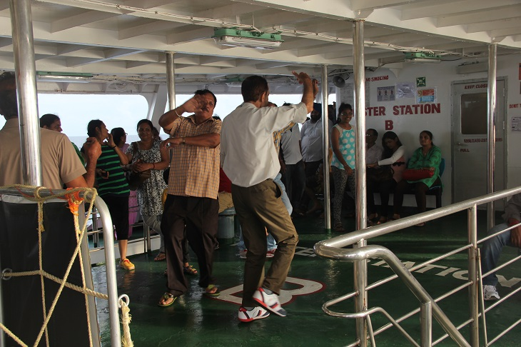 Perty time - Indian tourists dancing on the deck