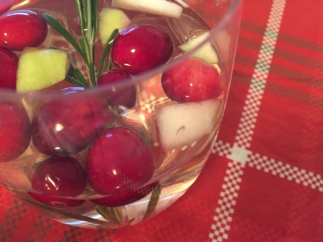 White wine sangria with apple, cranberry and rosemary
