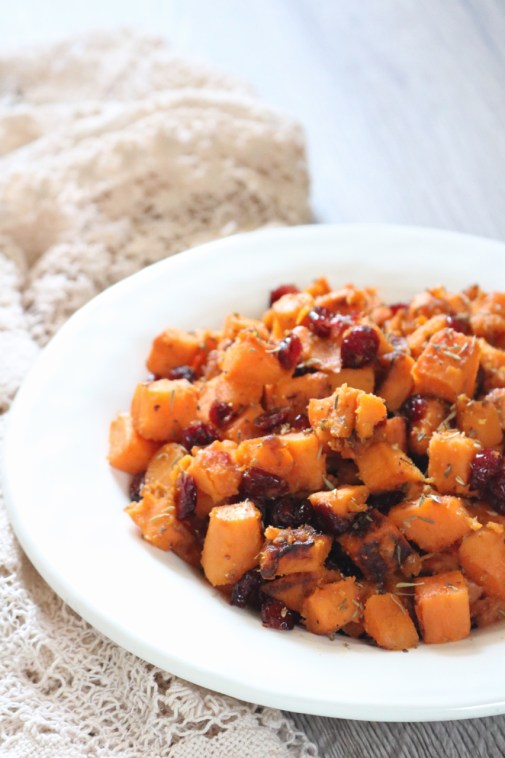 Sweet & Savory Thanksgiving Sweet Potatoes | All the best fall flavors come together in these sweet potatoes cooked with savory herbs and tangy cranberries. Plus a vegan option so everybody can enjoy at holiday dinners! | asliceofky.com