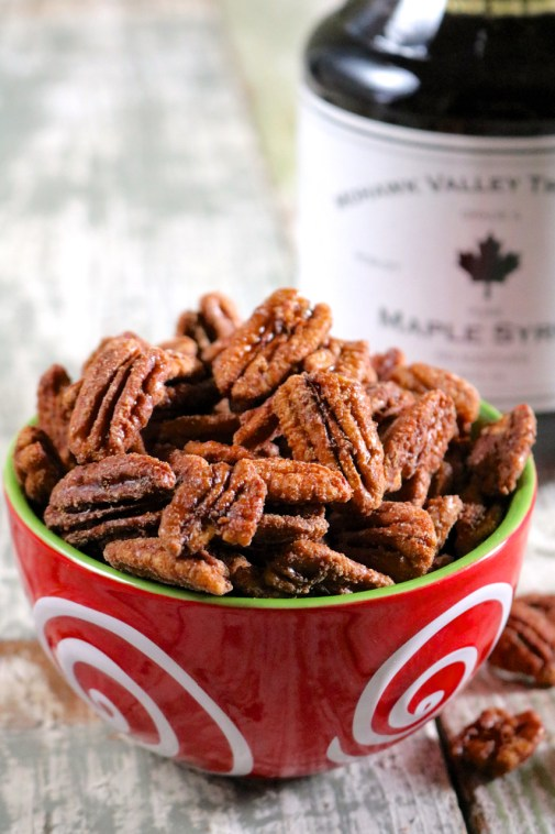 15 Minute Maple Cinnamon Candied Pecans | 3 ingredients and 15 minutes is all you need to make these maple cinnamon candied pecans. Try them as an ice cream topping. Gluten free, vegan, and paleo. | eatsomethingdelicious.com