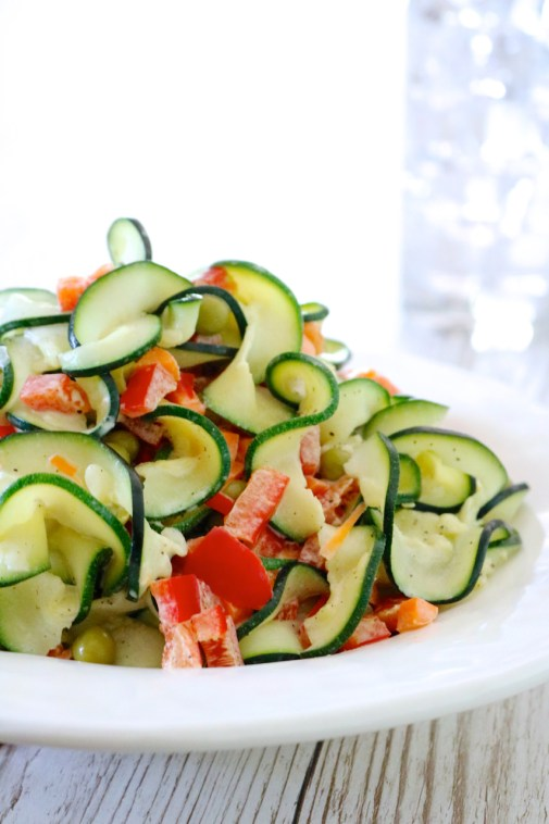 Less Pasta, More Salad | Pasta salad made with zoodles (spiralized zucchini) instead of noodles. Tossed in a mayo-mustard dressing for a change from the traditional vinaigrettes. | eatsomethingdelicious.com