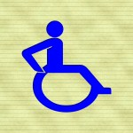 A blue handicapped symbol over a lined paper background.