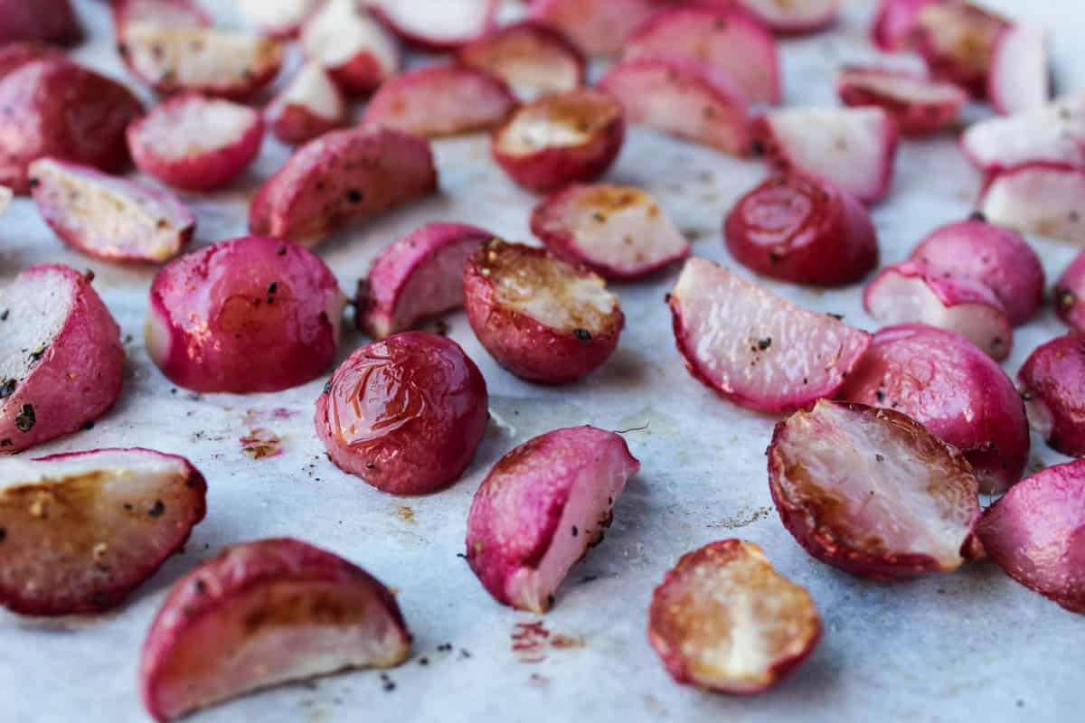 An easy and low carb alternative to potatoes, theseRosemary Roasted Radishes are a perfect paleo, vegan, and Whole30 approved side dish - Eat the Gains