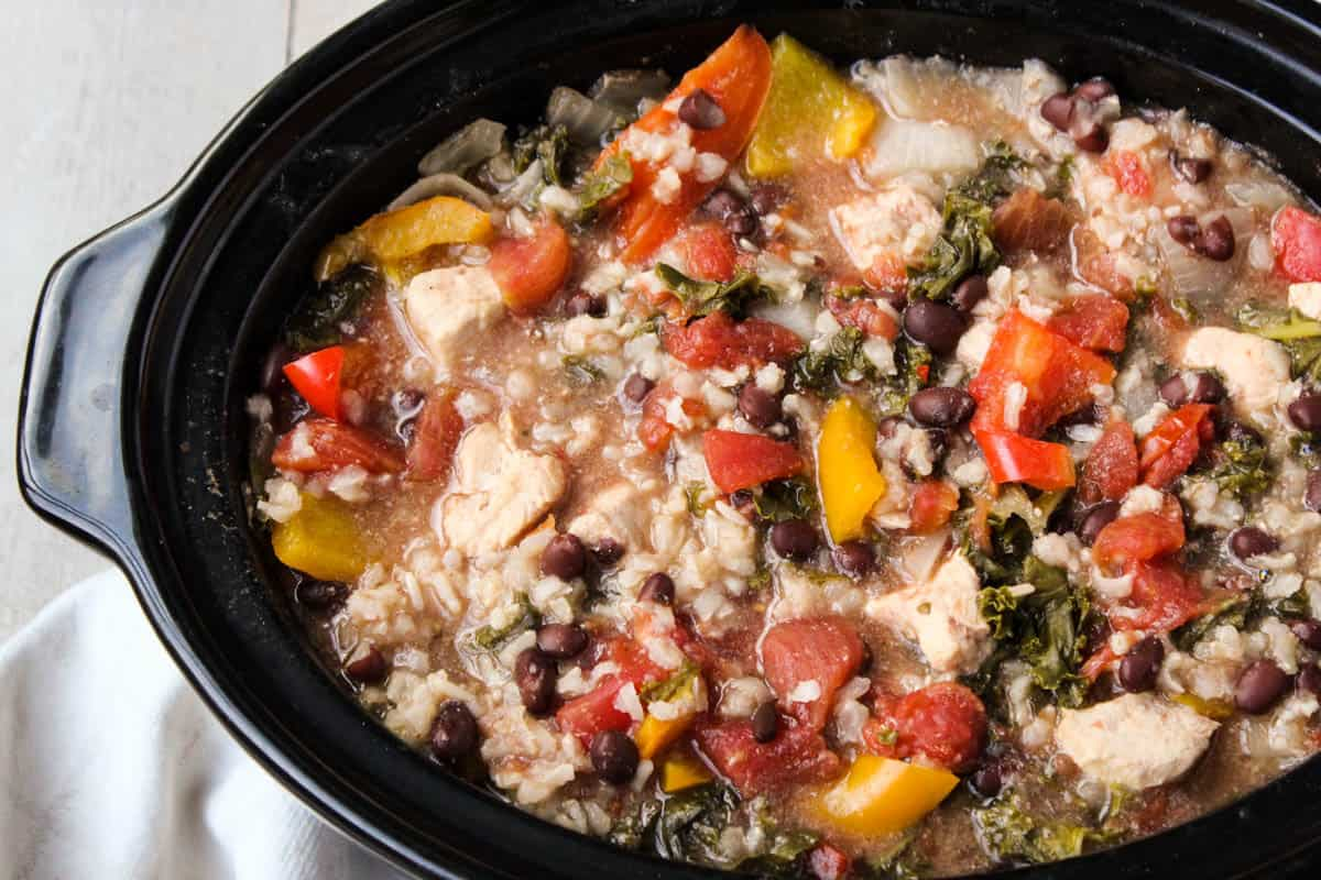 An easy dump and set meal, this Slow Cooker Chicken Fajita Soup has all the main ingredients for chicken fajitas in a delicious, comforting, and healthy soup - Eat the Gains