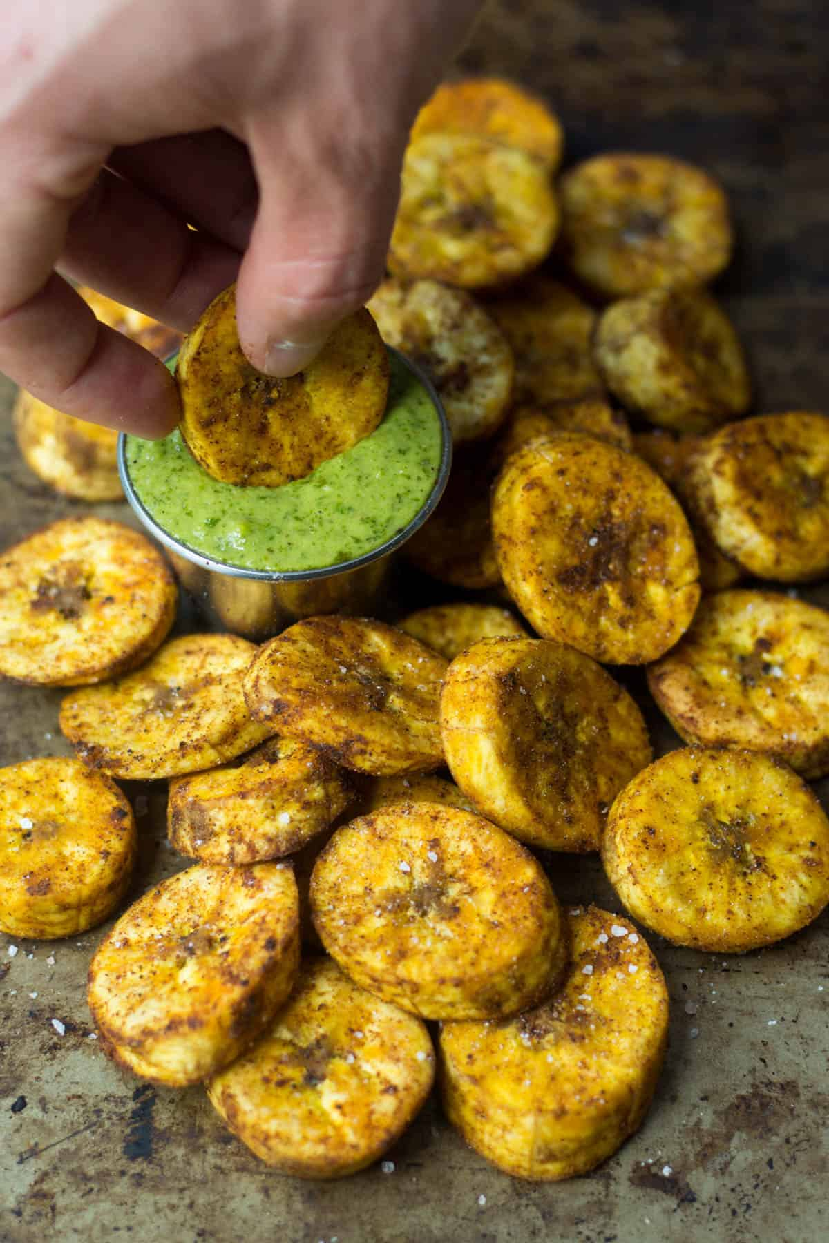 A great carb source, these Sweet & Spicy Baked Plantains are an easy side for breakfast or dinner and are paleo, vegan, and Whole30 approved! - Eat the Gains