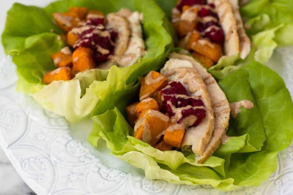 A lightened up version of your thanksgiving leftover sandwich, Turkey Cranberry Lettuce Wraps make a great low carb, gluten free, paleo, and Whole30 meal! - Eat the Gains