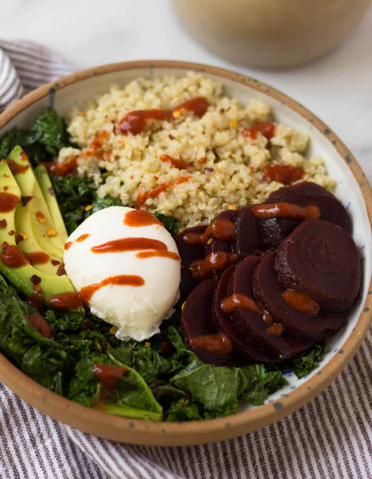 Beet Quinoa Breakfast Bowls come together in under 10 mins and make a healthy and easy gluten free and vegetarian breakfast - great for meal prep or on-the-go! - Eat the Gains