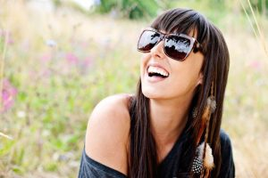 woman-in-sunglasses-in-meadow