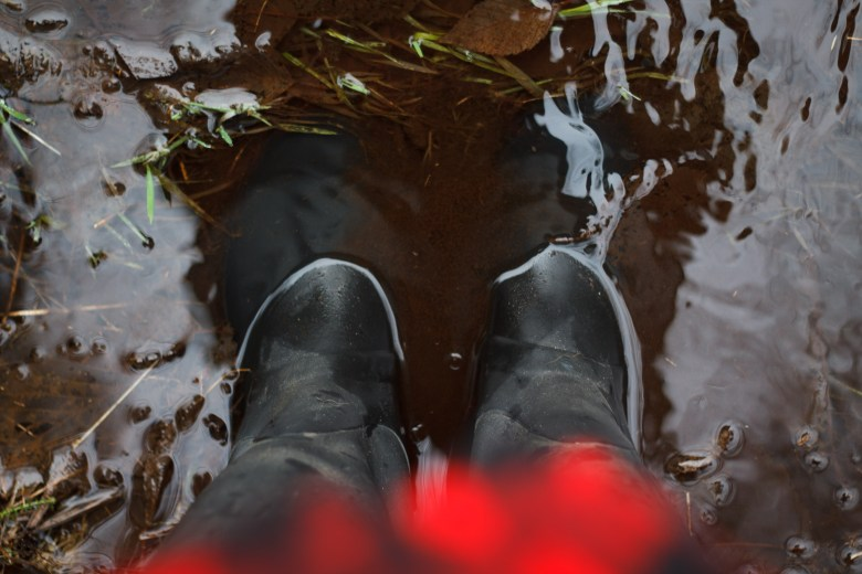 Testing for leakage in repaired Hunter boots.