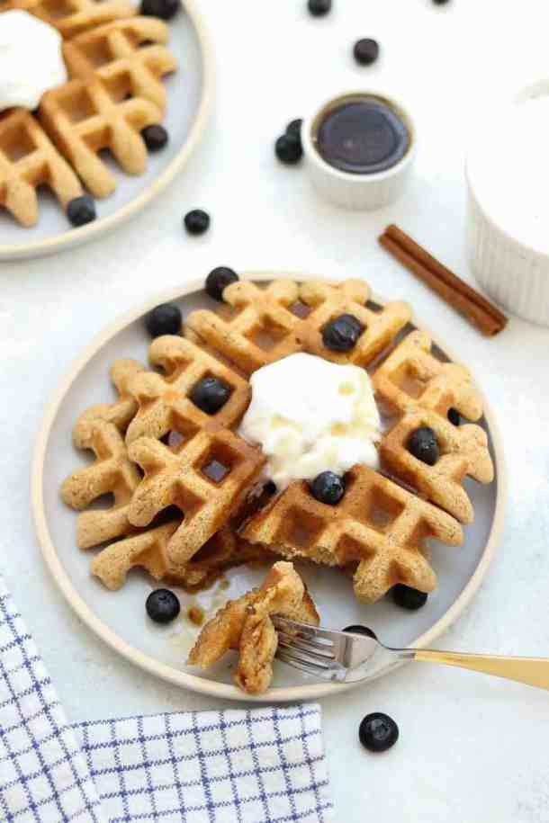 The best vegan almond flour waffles drizzled with maple syrup!