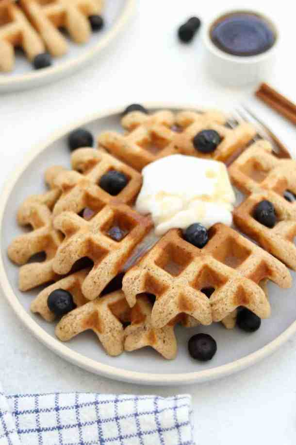 Who wants a bite of these easy almond flour waffles with coconut cream?