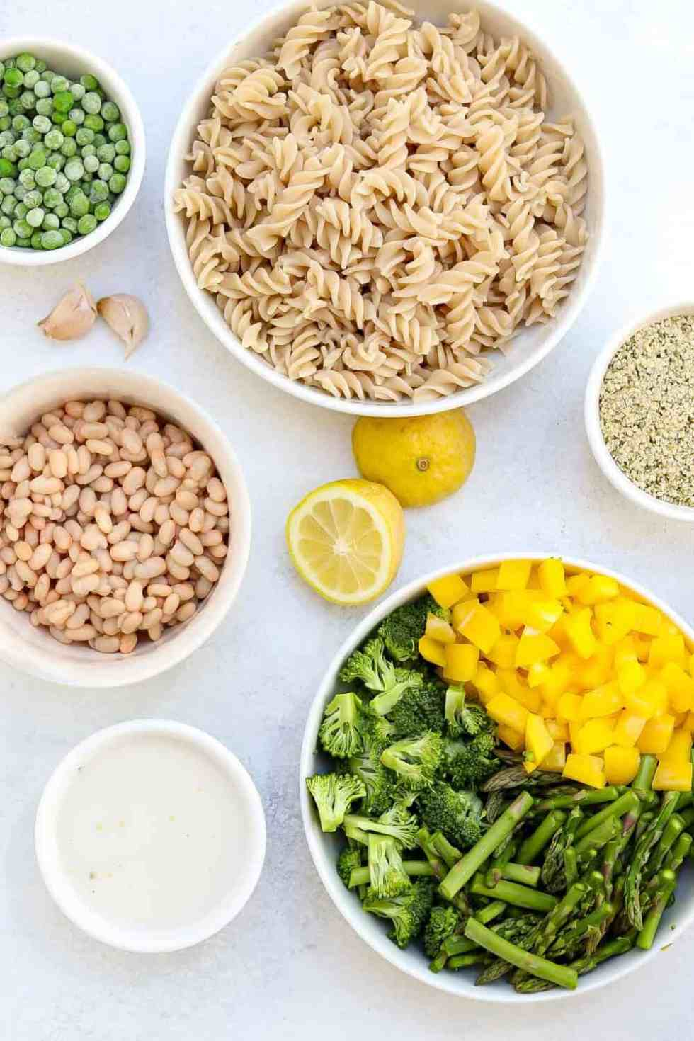 Ingredients for this recipe separated in white bowls on a white backdrop.