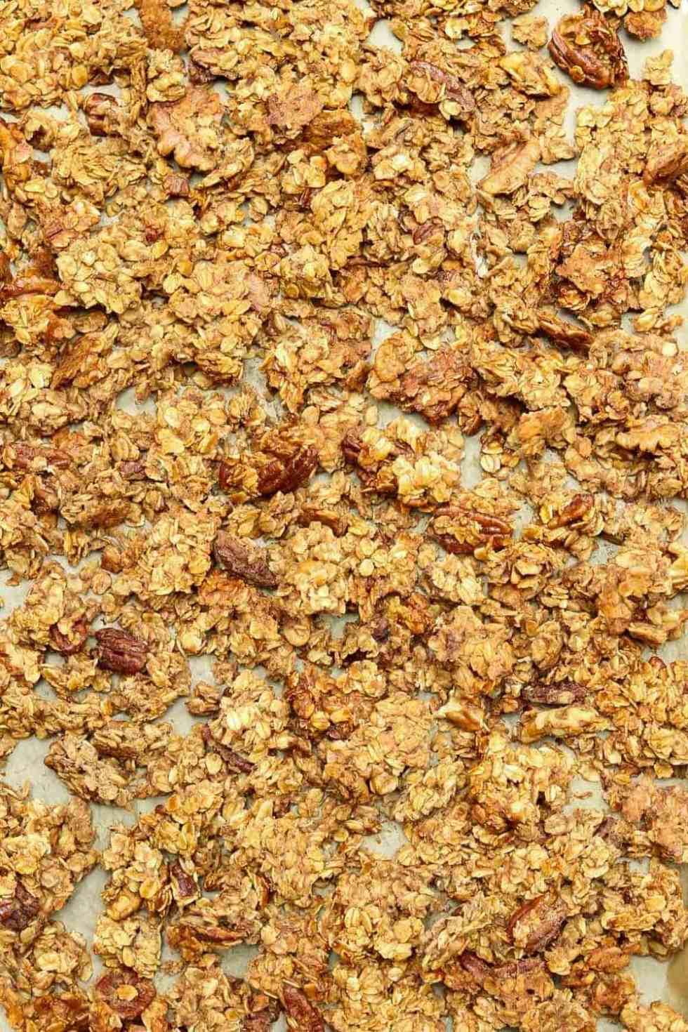 Up close of granola on a baking sheet.