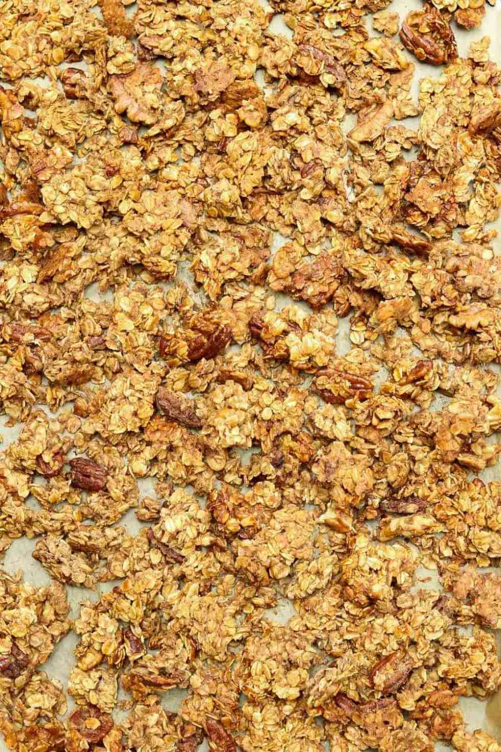 Up close of granola on a baking sheet.