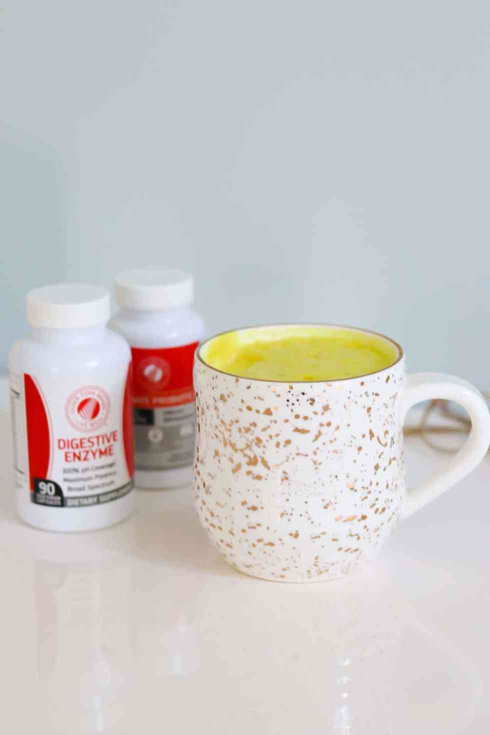 Digestive enzymes and a gold speckled mug. Helps to heal the gut naturally.