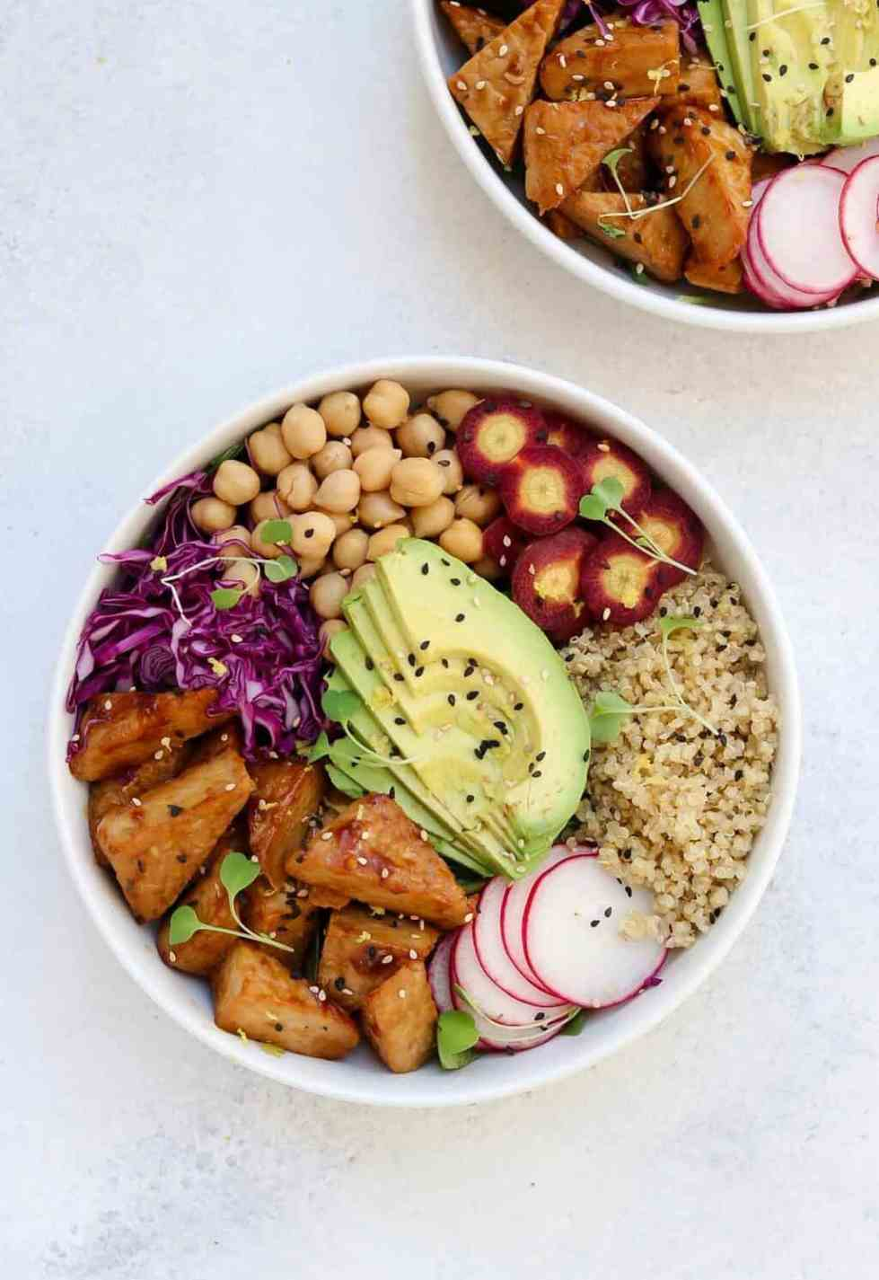 Easy buddha bowl in a white bowl with lots of vegetables.