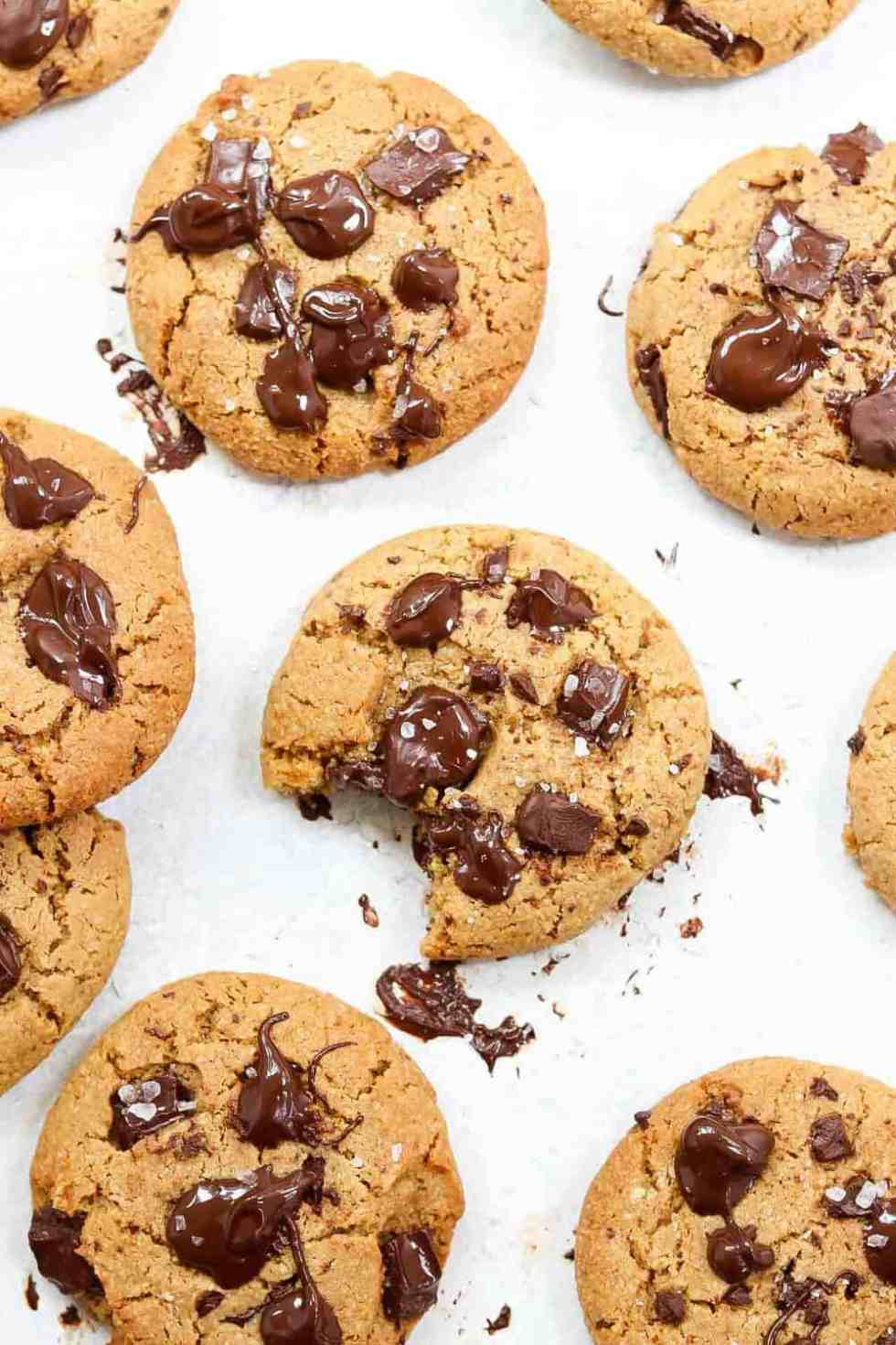 Cookies on a white backdrop with melted chocolate around the edges.