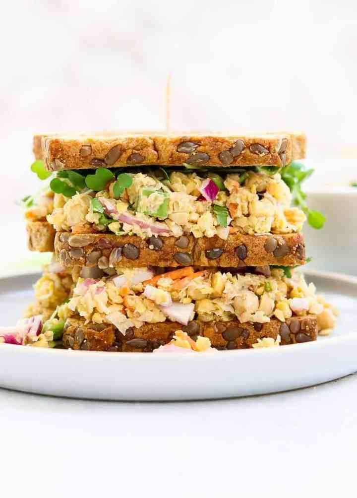 Chickpea tuna salad sandwich on a blue plate.