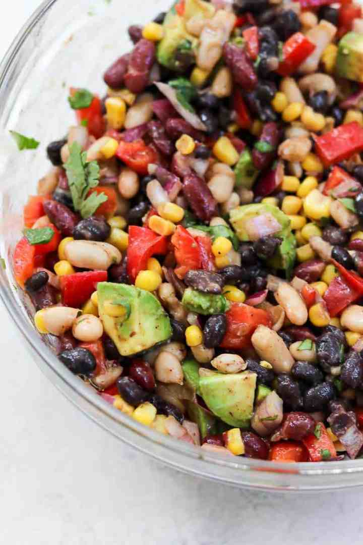 Large glass bowl with three bean salad.