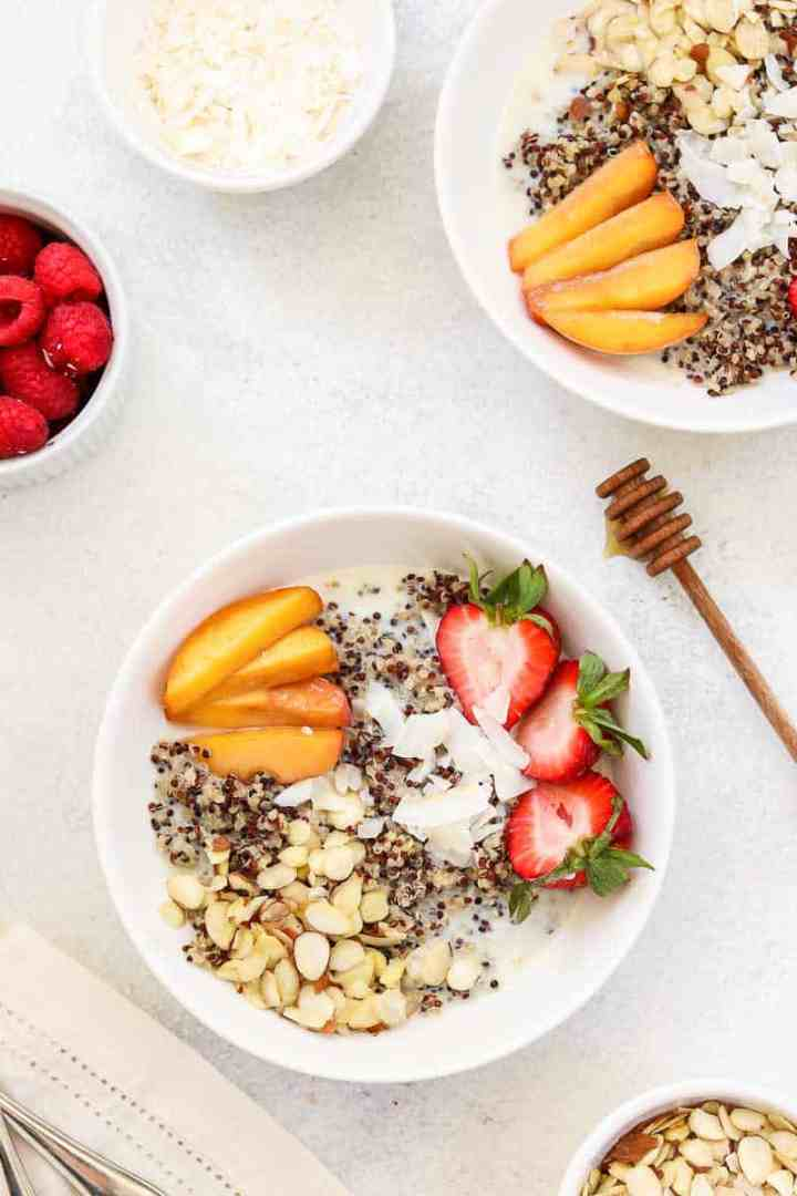 Overhead shot of breakfast bowl with peaches and berries.