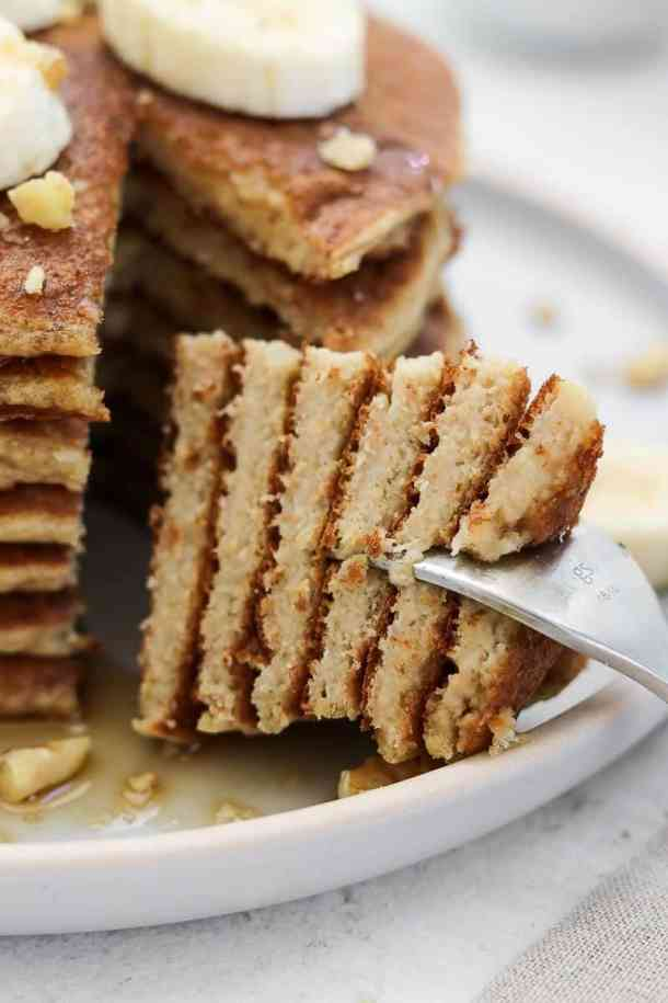 Up close shot of gluten free banana pancakes to show the layers.