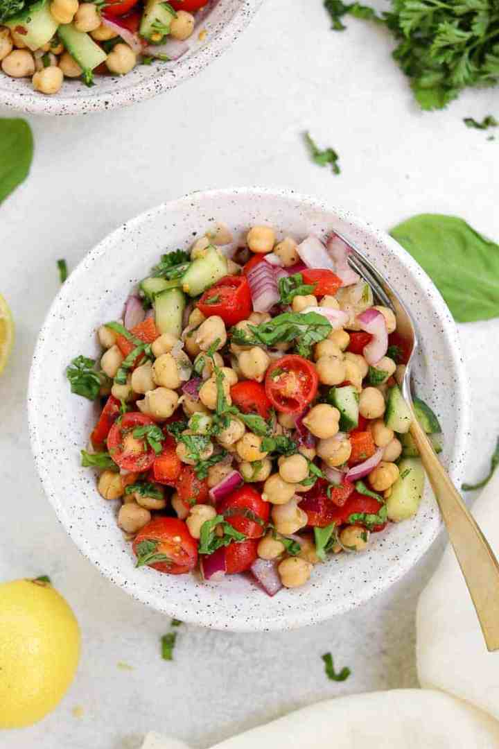 Chickpea salad with tomatoes, cucumber, onion and fresh basil.