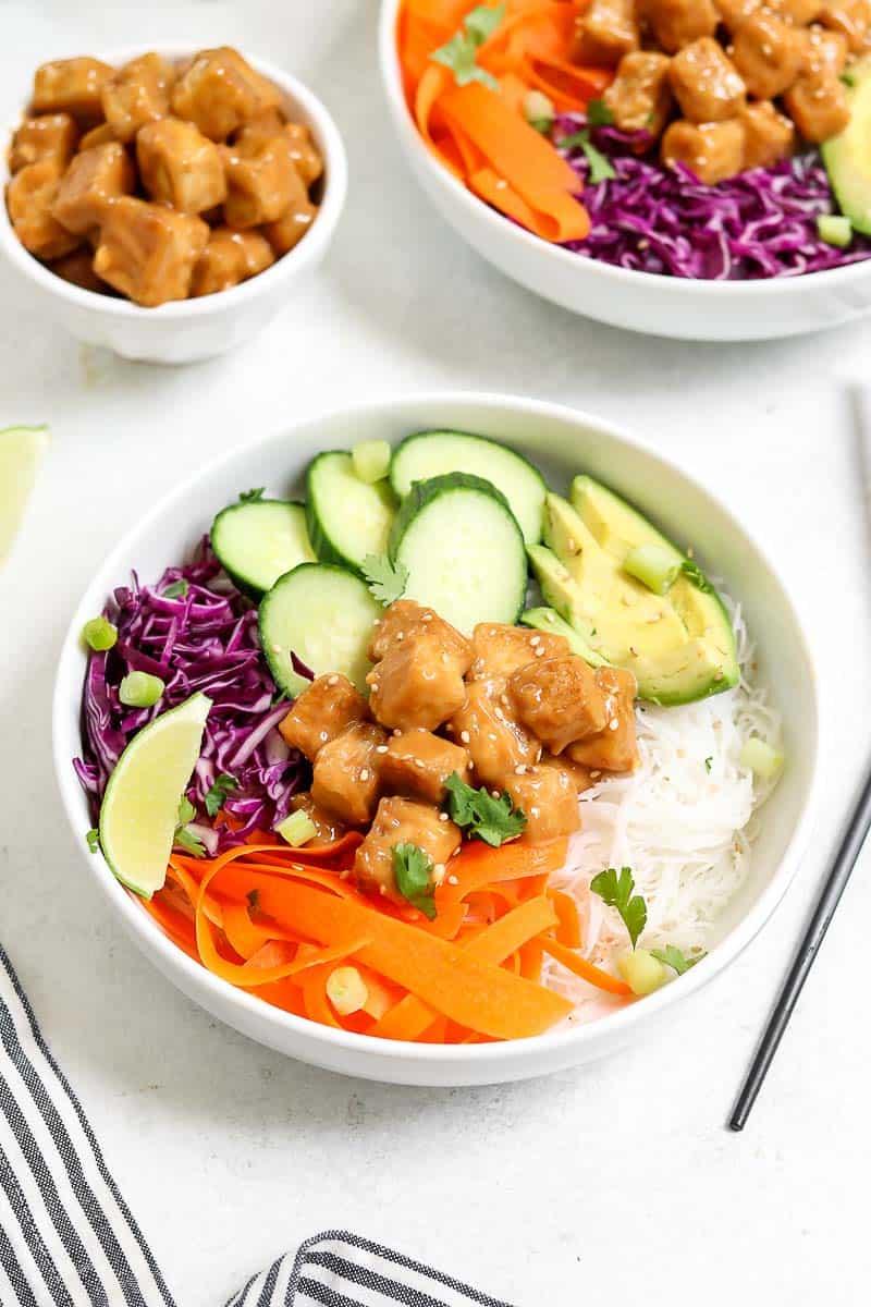 Peanut tofu buddha bowl with lots of colorful veggies.