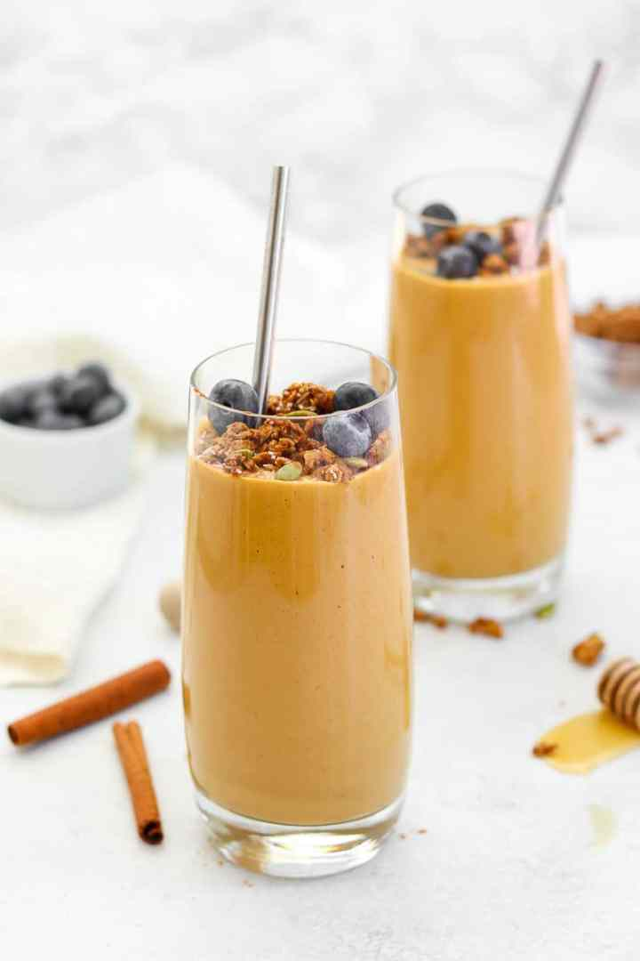 Sweet potato smoothie with granola and blueberries on top.