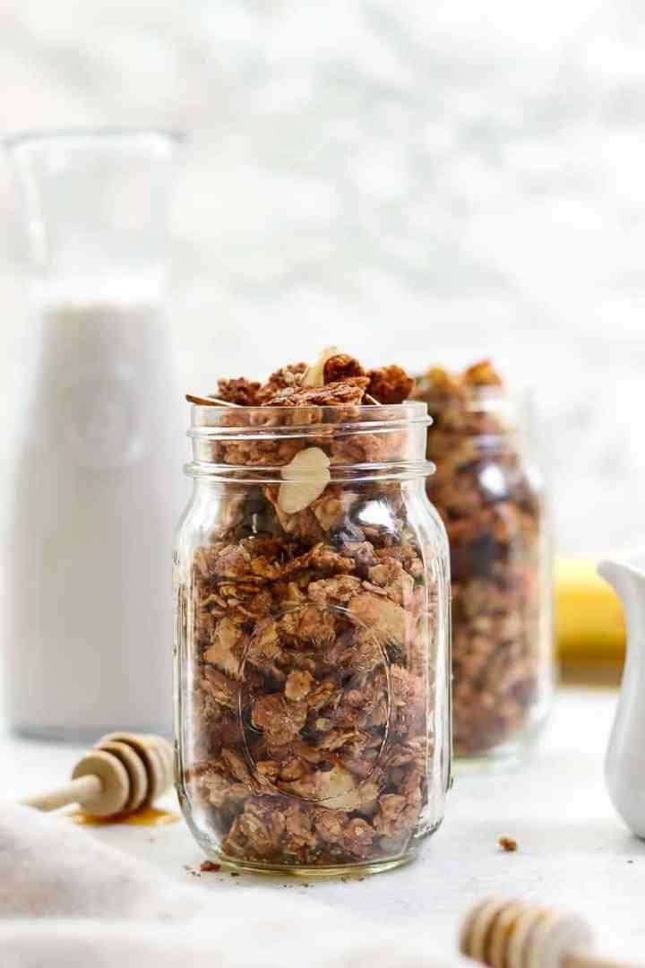 Vegan granola in a mason jar with milk.