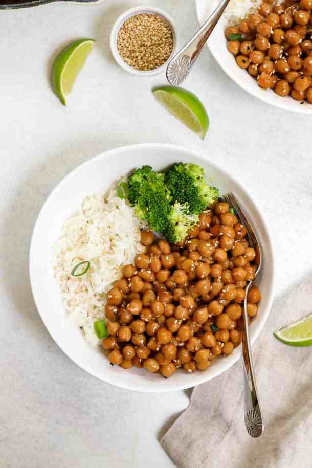 Sesame chickpea recipe in a white bowl with rice and broccoli.