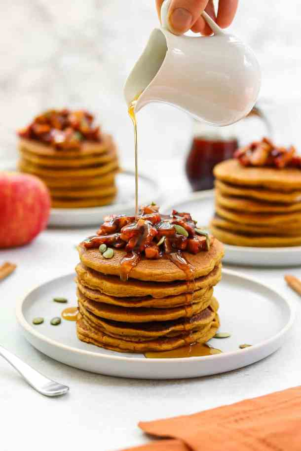 Sweet potato pancakes with apples and maple syrup on top.