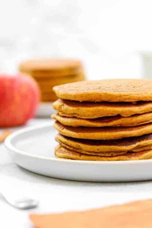 Plain sweet potato pancakes on a blue plate.