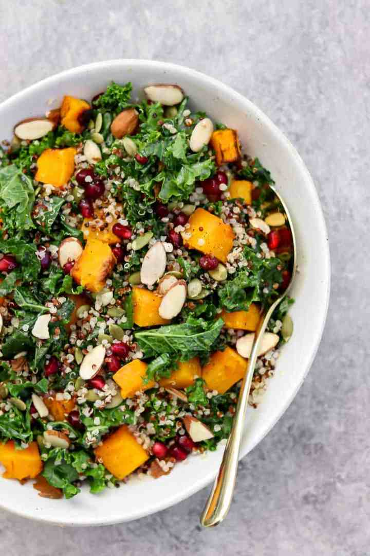 Butternut squash and kale salad with pomegranate and quinoa.