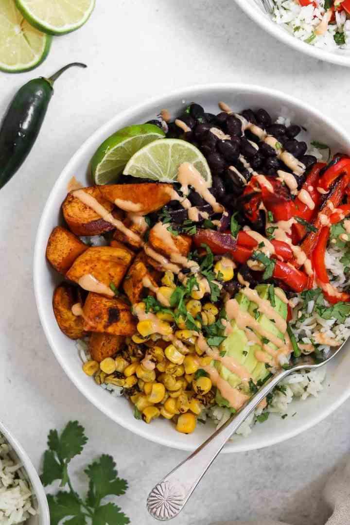 Vegan burrito bowl with rice and black beans.