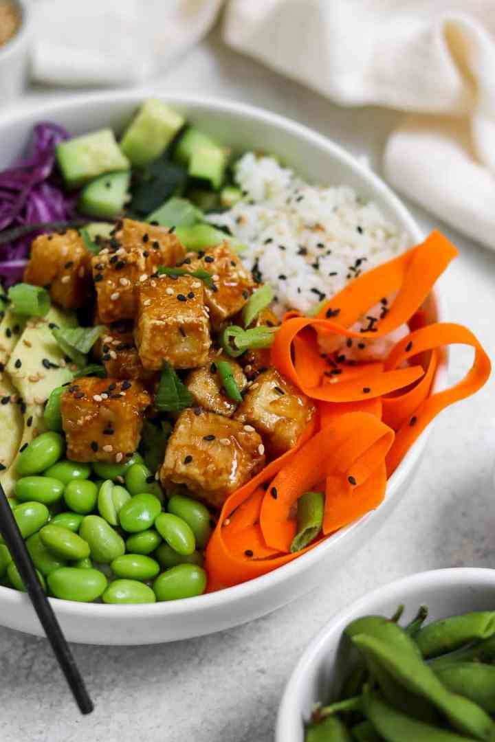 Vegan poke bowl with teriyaki tofu.