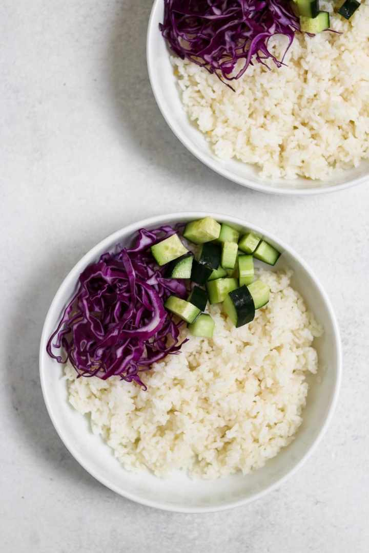 Rice with veggies in a white bowl.