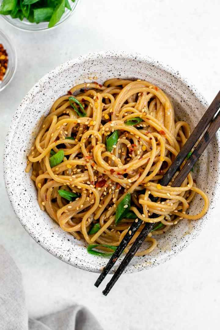 Sesame noodles with chopsticks.