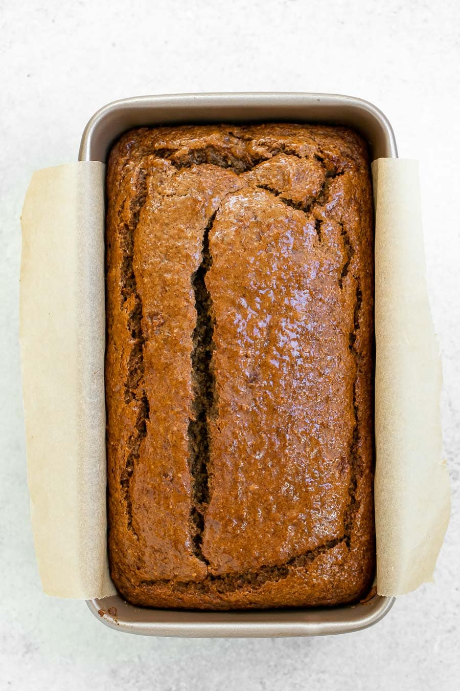 Fresh banana bread in a pan out of the oven.