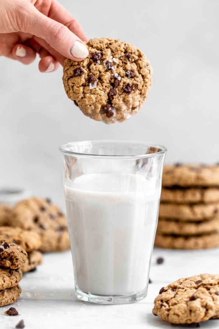 Dunking a cookie in a glass of milk.