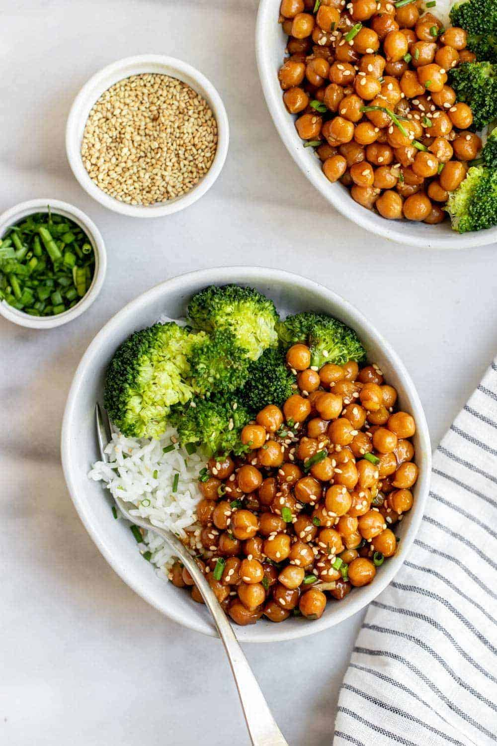 Sticky sesame chickpea recipe with rice and broccoli in a small bowl.
