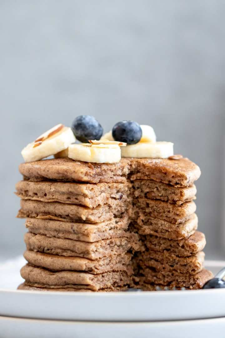 Vegan buckwheat pancakes with slices cut out of the sides.