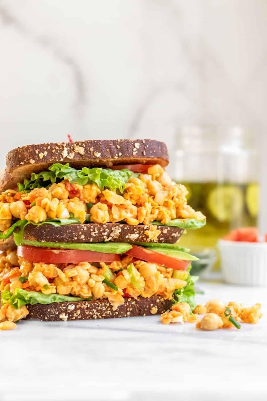 Buffalo chickpea salad sandwich between bread.