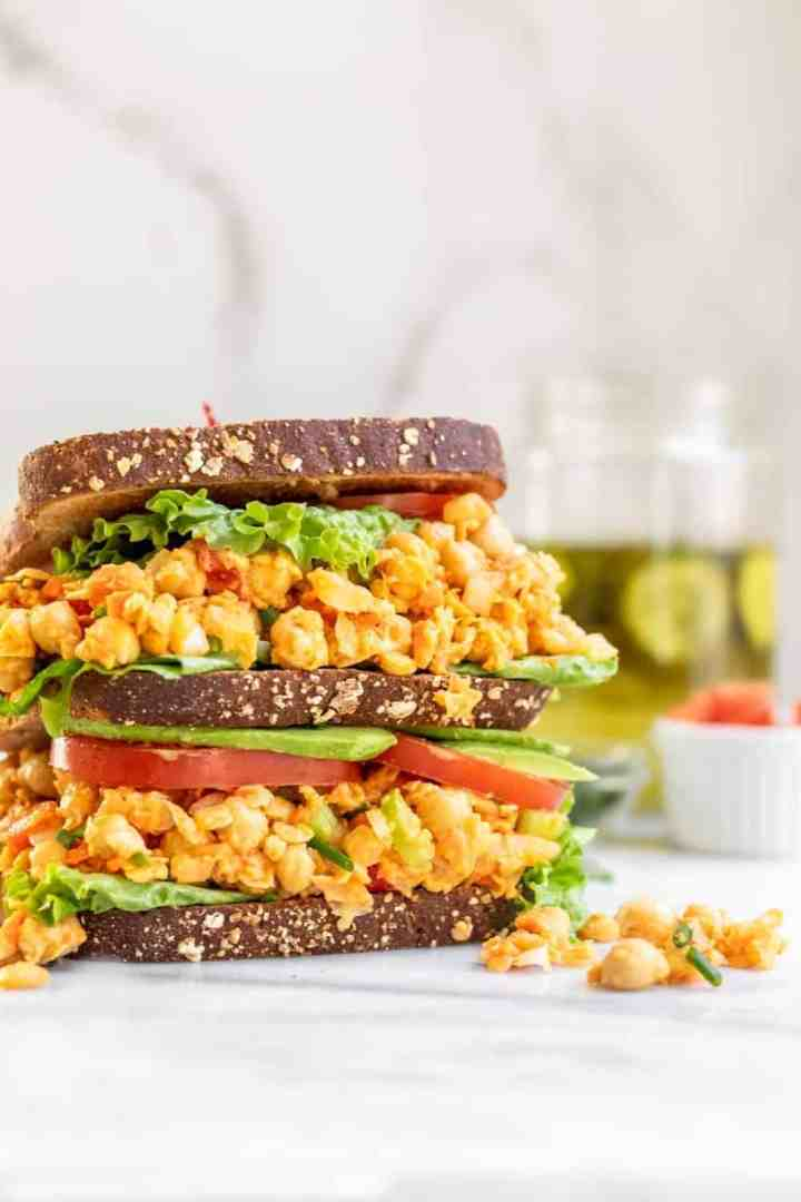 Double decker sandwich with chickpea salad, lettuce and tomato.