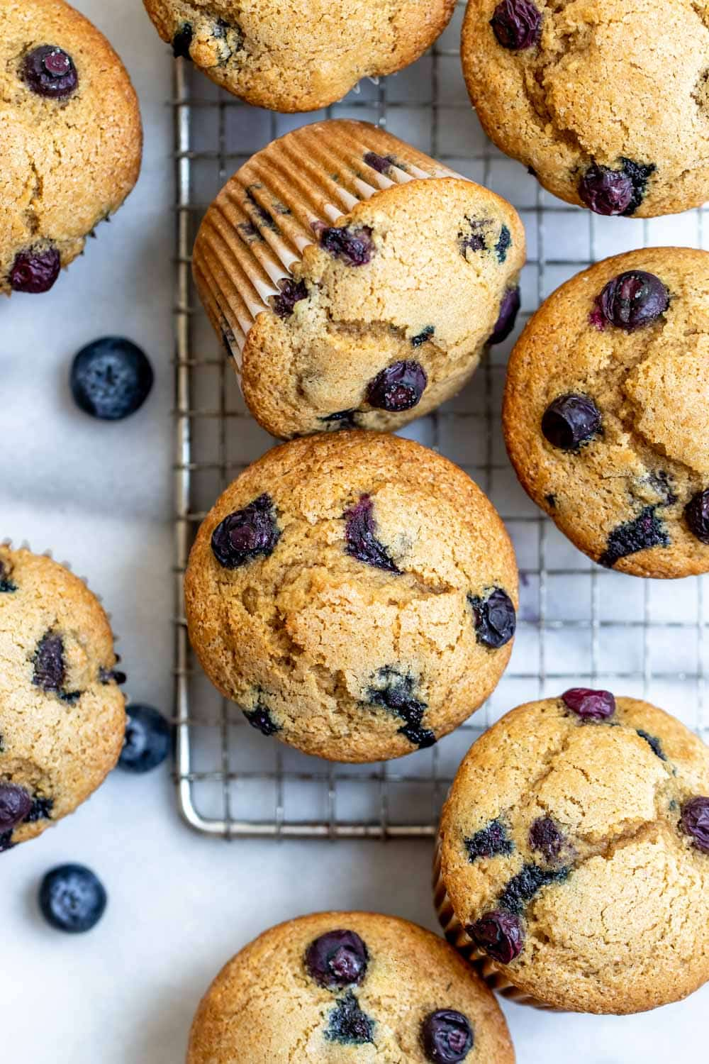 Overhead shot of the muffins with blueberries on the side.