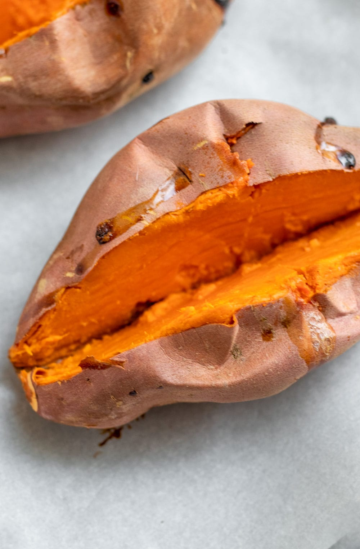 Baked sweet potatoes sliced in half.