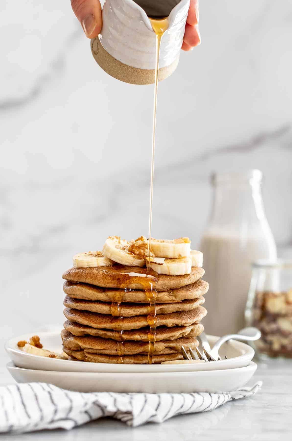 Vegan banana pancakes with maple syrup.