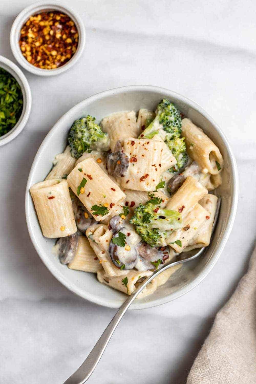 Vegan mushroom broccoli pasta with garlic sauce.