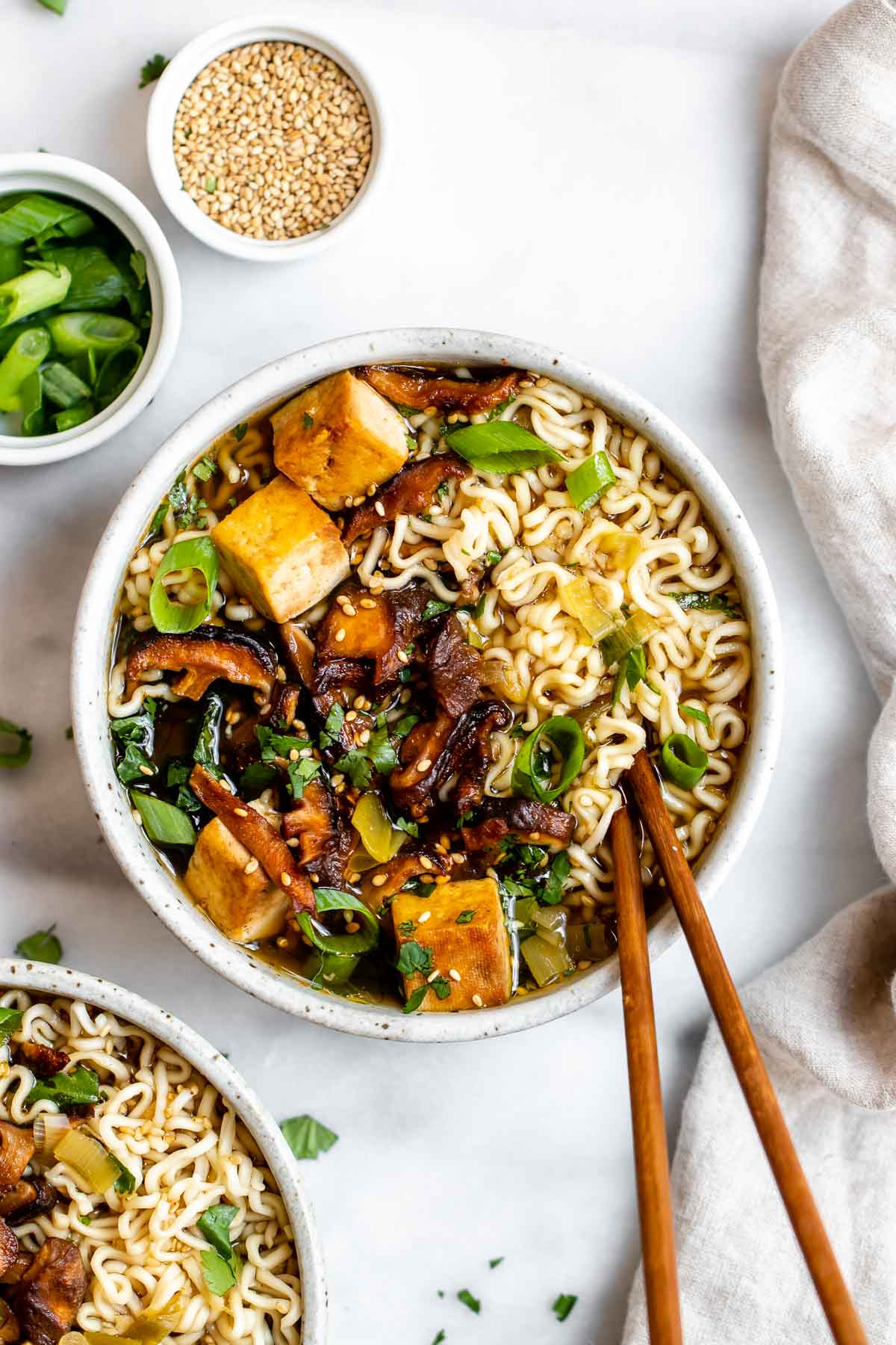 Vegan ramen noodles with mushrooms and tofu in a small bowl.