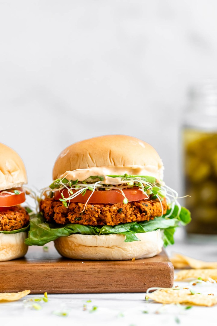 Chickpea burger with lettuce, tomato and tahini dressing.
